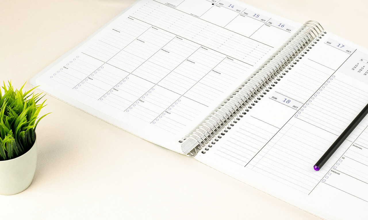 Agendio Open agendio column planner with a spiral cover