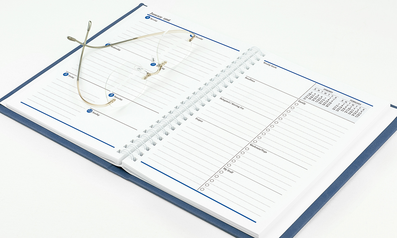 Agendio blue medium customizable planner with a wrap cover