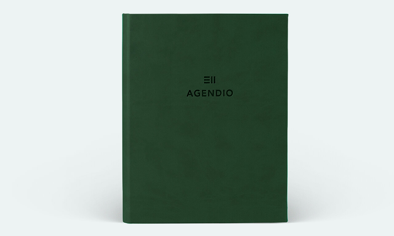 Agendio planner with a forest green wrap cover