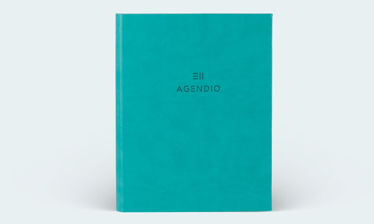 Agendio planner with a turquoise wrap cover