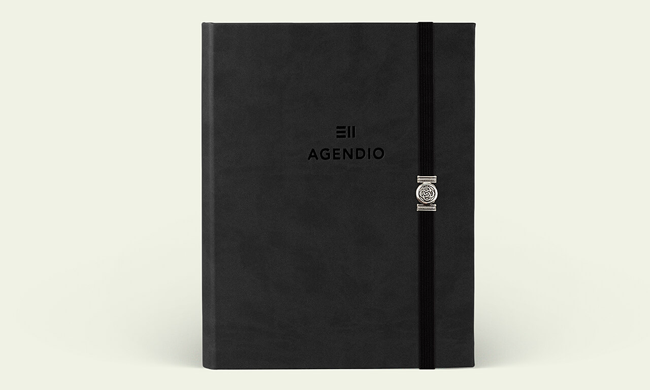 Agendio planner with a black eco-leather wrap cover