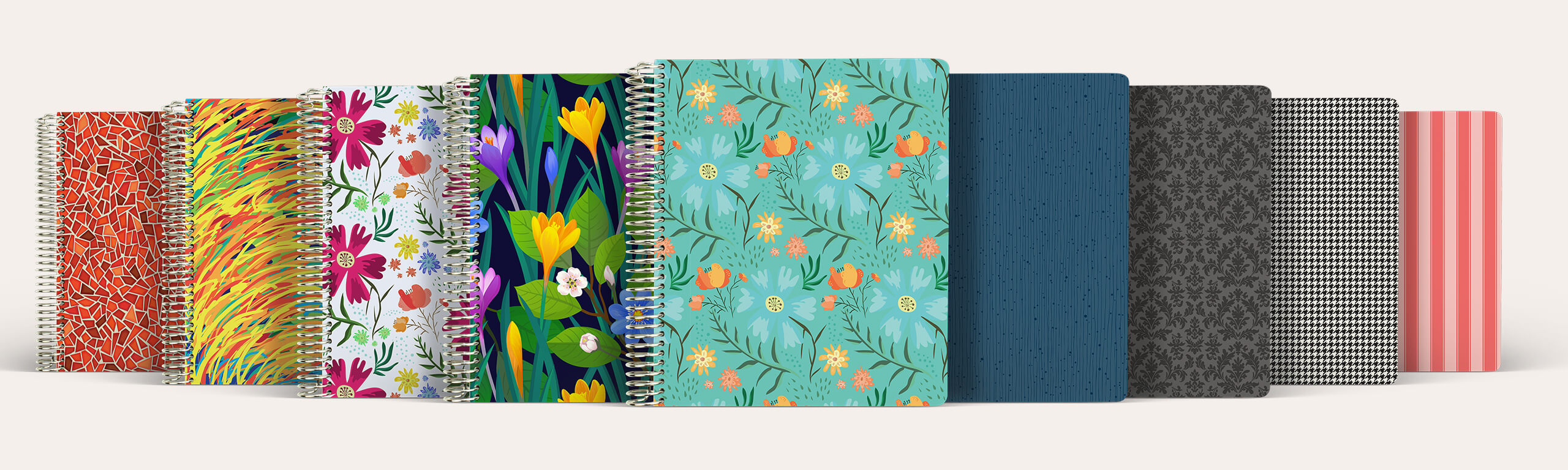 Agendio customizable spiral-bound planners available in multiple cover patterns.
